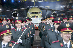 A military orchestra performs during the presentation of the new Antonov An-178 plane at the Antonov aircraft manufacturing plant in Kiev on April 16, 2015. The new Antonov cargo plane is designed to carry 18,000 kgs of payload and fly up to 12,200 meters. AFP PHOTO / GENYA SAVILOV