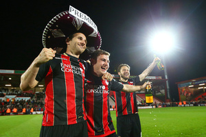(L-R) Marc Pugh, Ryan Fraser and Harry Arter of Bournemouth celebrate victory on the pitch after the Sky Bet Championship match between AFC Bournemouth and Bolton Wanderers at Goldsands Stadium on April 27, 2015 in Bournemouth, England. Bournemouth's 3-0 victory puts them on the brink of promotion to the Barclays Premier League.