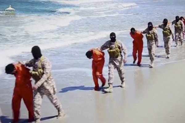 Islamic State militants lead what are said to be Ethiopian Christians along a beach in Wilayat Barqa, in this still image from an undated video made available on a social media website on April 19, 2015. The video purportedly made by Islamic State and posted on social media sites on Sunday appeared to show militants shooting and beheading about 30 Ethiopian Christians in Libya. Reuters was not able to verify the authenticity of the video but the killings resemble past violence carried out by Islamic State, an ultra-hardline group which has expanded its reach from strongholds in Iraq and Syria to conflict-ridden Libya. Libyan officials were not immediately available for comment. Ethiopia said it had not been able to verify whether the people shown in the video were its citizens. REUTERS/Social Media Website via Reuters TV