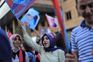 Aug. 13, 2014 - Istanbul, Turkey - A Turkish girl wears a head band that reads ''Recep Tayyip Erdogan'' as she holds Turkey flag during a rally march for celebrate presidential victory of Erdogan in Istanbul August 13, 2014. Erdogan secured his place in history as Turkey's first directly elected president on Sunday, sweeping more than half the vote in a result his opponents fear heralds an increasingly authoritarian state. (Credit Image: © Ahmed Deeb/NurPhoto/ZUMA Wire)
