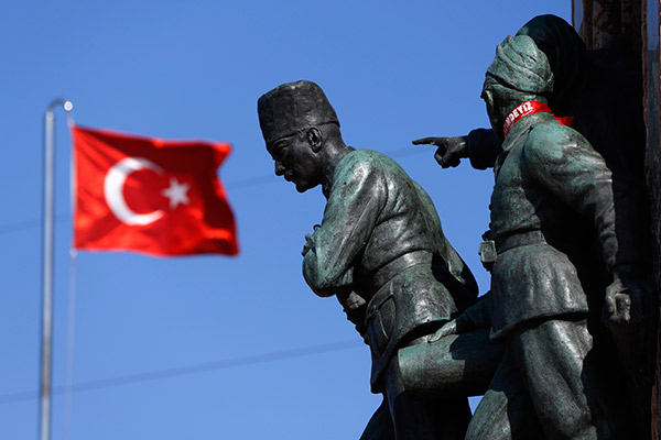 Turkish flag flutters near the monument of Mustafa Kemal Ataturk at Taksim Square in Istanbul June 24, 2013. REUTERS/Marko Djurica
