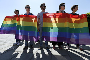 Activists hold rainbow flags as they take part in the so-called Equality March, organized by a lesbian, gay, bisexual and transgender (LGBT) community, in Kiev, Ukraine, June 6, 2015. REUTERS/Stringer - RTX1FCGL