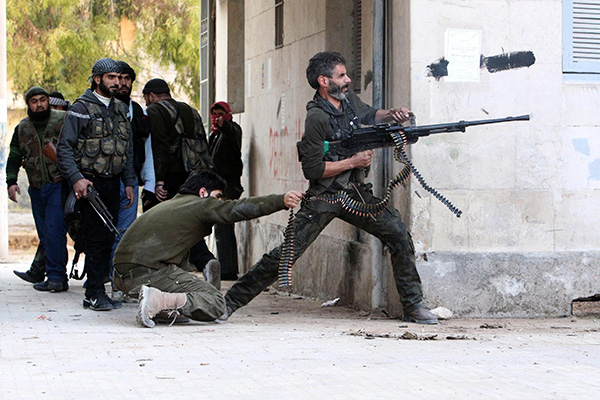 A Free Syrian Army fighter fires his weapon during clashes with forces loyal to Syria's President Bashar Al-Assad in Aleppo's Bustan al-Qasr district December 30, 2012. REUTERS/Muzaffar Salman (SYRIA - Tags: CONFLICT POLITICS TPX IMAGES OF THE DAY) - RTR3BZGI