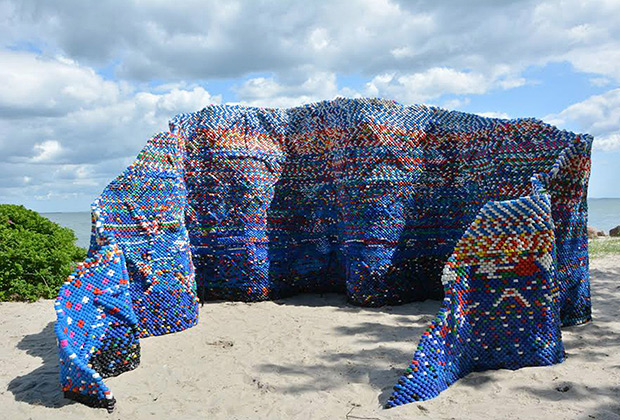 Photographer Arunkumar H G/REX Artist builds bottle cap pavilion with 70,000 disused plastic pieces, Aarhus, Denmark - Jul 2015 Artist Arunkumar H G sculpture Droppings and the Dam(n) is an artwork made of more than 75,000 bottle screw caps collected over a year. 8 Jul 2015