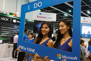Promotional models pose at the Microsoft Windows 10 booth at Ani-Com & Games Hong Kong in Hong Kong, China July 27, 2015, two days before its global official launch. REUTERS/Bobby Yip - RTX1LYD3