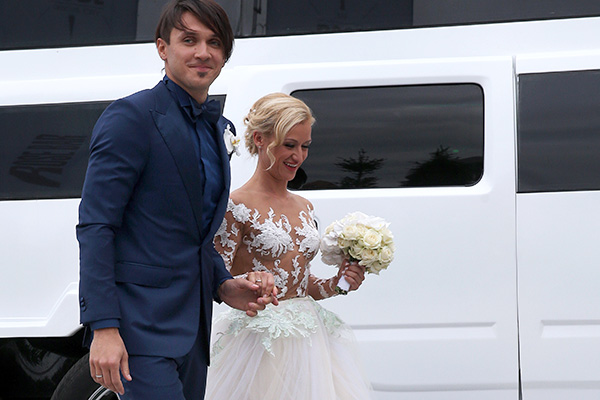 MOSCOW, RUSSIA. AUGUST 18, 2015. Two-time Olympic figure skating champions Maxim Trankov (L) and Tatiana Volosozhar during their wedding at the Rose Bar restaurant. Vyacheslav Prokofyev/TASS