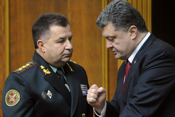 Ukraine's President Petro Poroshenko, right, speaks with new defense minister Stepan Poltorak in parliament in Kiev, Ukraine, Tuesday, Oct. 14, 2014. Ukraine's parliament has approved a new defense minister as the country remains bogged down in daily clashes with pro-Russian separatist forces in its industrial eastern regions. (AP Photo/Andrew Kravchenko,