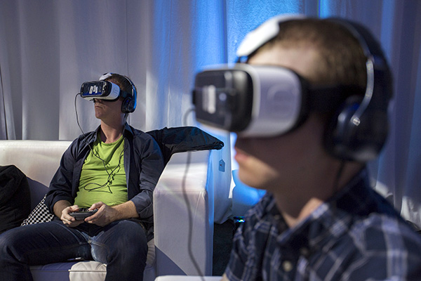 "Guests use Gear VR virtual reality headsets during a preview session in Hollywood, California September 24, 2015. Oculus and Samsung Electronics unveiled a new version of Gear VR virtual reality headset for $99, half the price of the previous ""Innovator Edition"", and said the product would be available in the United States in time for Black Friday and globally shortly after.  REUTERS/Mario Anzuoni - RTX1SCZ8"