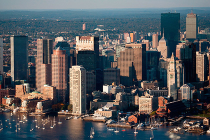 16 Oct 2011, Boston, Massachusetts, USA --- AERIAL morning view of Boston Skyline and Financial District and Wharf area, Boston, MA --- Image by © Joseph Sohm/Corbis