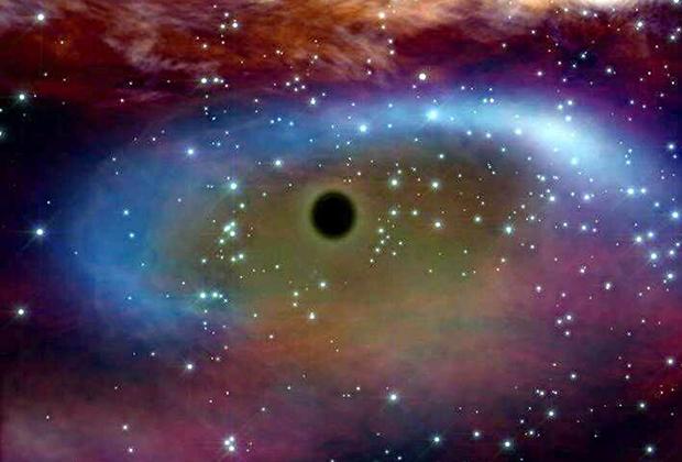Сверхмассивная чёрная дыра потребляет материю вращающейся вокруг нее звезды (в представлении художника)