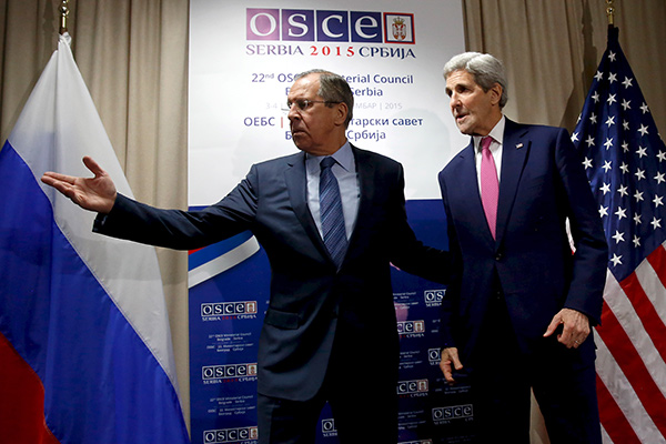 Sergei Lavrov (L) greets U.S. Secretary of State John Kerry as he arrives for their bilateral alongside the OSCE Ministerial Council meeting in Belgrade, Serbia December 3, 2015. REUTERS/Jonathan Ernst
