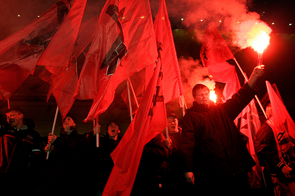 Members of the left-wing organization Avant-guard of the Communist Youth,  light flares and shout slogans during a rally to commemorate the Bolshevik Revolution, marking a long-sacred former holiday that was an official working day for the first time in decade, in Moscow, Monday, Nov. 7, 2005. President Vladimir Putin signed a law late last year canceling the Nov. 7 holiday that used to mark the anniversary of the 1917 revolution and replacing it with the Day of People's Unity, a Nov. 4 celebration of the end of Polish intervention in 1612. (AP Photo/Ivan Sekretarev)