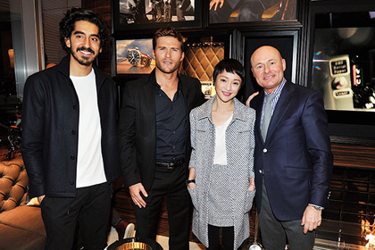 GENEVA, SWITZERLAND - JANUARY 19: Dev Patel, Scott Eastwood, Zhou Xun and IWC Schaffhausen CEO Georges Kern visits the IWC booth during the launch of the Pilot's Watches Novelties from the Swiss luxury watch manufacturer IWC Schaffhausen at the Salon International de la Haute Horlogerie (SIHH) 2016 on January 19, 2016 in Geneva, Switzerland. (Photo by Harold Cunningham/Getty Images for IWC) *** Local Caption *** Dev Patel; Scott Eastwood; Zhou Xun; Georges Kern