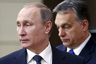 Russian President Vladimir Putin (L) and Hungarian Prime Minister Viktor Orban arrive for a joint news conference following their talks at the Novo-Ogaryovo state residence outside Moscow, Russia, February 17, 2016. REUTERS/Maxim Shipenkov/Pool - RTX27DWX