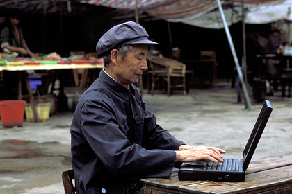 Asia, China, Shanghai. Man with laptop. MR.