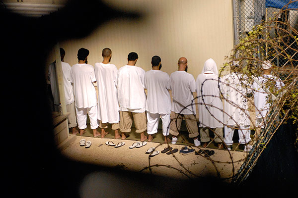 "A group of detainees observe morning prayer before sunrise inside Camp Delta at Guantanamo Bay naval base in an October 28, 2009 file photo provided by the US Department of Defense. President Barack Obama urged lawmakers on Tuesday to give his plan to close the U.S. military prison at Guantanamo Bay, Cuba, a ""fair hearing"" and said he did not want to pass the issue to his successor when he leaves the White House next year"