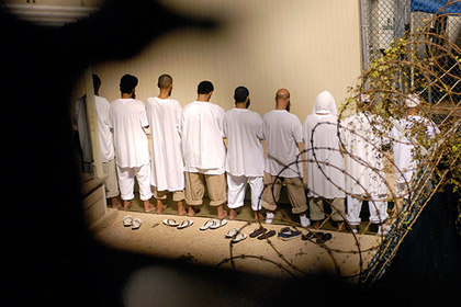 """A group of detainees observe morning prayer before sunrise inside Camp Delta at Guantanamo Bay naval base in an October 28, 2009 file photo provided by the US Department of Defense. President Barack Obama urged lawmakers on Tuesday to give his plan to close the U.S. military prison at Guantanamo Bay, Cuba, a """"fair hearing"""" and said he did not want to pass the issue to his successor when he leaves the White House next year"""