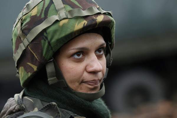 Ukrainian servicewoman Nadie, 36, stands at the military camp in the village of Luhanske, eastern Ukraine September 24, 2014.