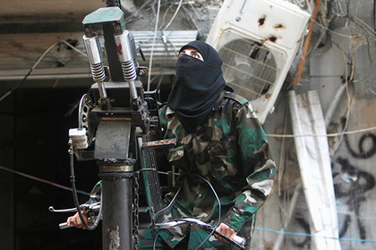 A female member of the Ahbab Al-Mustafa Battalion stands on a pick-up truck mounted with an anti-aircraft weapon as she undergoes military training in Aleppo's Salaheddine district June 24, 2013. Picture taken June 24, 2013. REUTERS/Muzaffar Salman