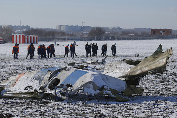Emergencies Ministry members work at the crash site of a Boeing 737-800 Flight FZ981 operated by Dubai-based budget carrier Flydubai, at the airport of Rostov-On-Don, Russia, March 20, 2016. REUTERS/Maxim Shemetov - RTSBA93