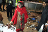 LAHORE, March 28, 2016 (Xinhua) -- A Pakistani woman stands with blood on her hands next to a body at the blast site in eastern Pakistan's Lahore, March 27, 2016. At least 63 people including women and kids were killed and over 306 others injured when a suicide bomber hit a public park in Lahore on Sunday evening, officials said. (Xinhua/Jamil Ahmed) (wyl) (Credit Image: Global Look Press via ZUMA Press)