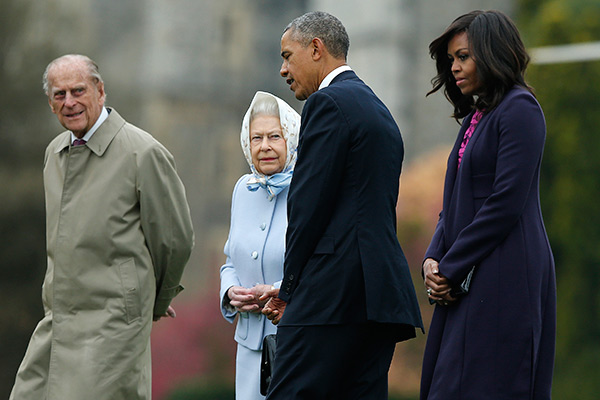President Barack Obama and his wife first lady Michelle Obama are greeted by Britain's Queen Elizabeth II and Prince Phillip after landing by helicopter at Windsor Castle for a private lunch in Windsor, England, Friday, April, 22, 2016. (AP Photo/Alastair Grant Pool)