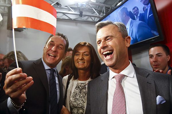 Presidential candidate Norbert Hofer (R) and head of the Austrian Freedom party Heinz-Christian Strache (L) react at the party headquarter in Vienna, Austria, April 24, 2016. REUTERS/Heinz-Peter Bader  - RTX2BG8M