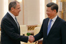 Russian Foreign Minister Sergey Lavrov, left, is greeted by China's President Xi Jinping as they meet at the Great Hall of the People in Beijing, Thursday, April 28, 2016. (Damir Sagolj/Pool Photo via AP)