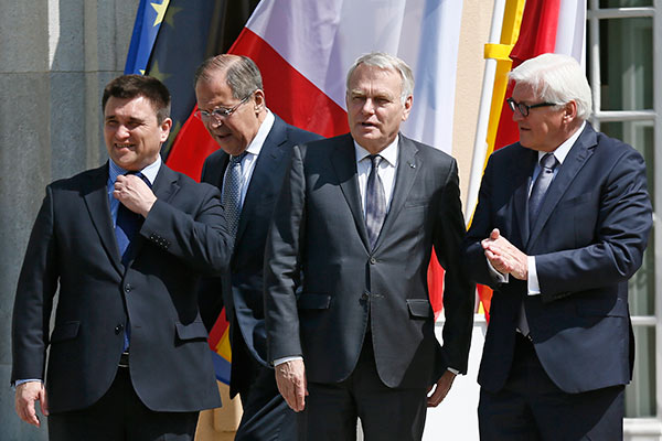 Foreign ministers Sergei Lavrov of Russia, Pavlo Klimkin of Ukraine, Jean-Marc Ayrault of France and Frank-Walter Steinmeier of Germany (L-R) arrive to pose for a picture outside German foreign ministry's guest house Villa Borsig in Berlin, Germany, May 11, 2016, ahead of their meeting to discuss Ukraine crisis. REUTERS/Hannibal Hanschke
