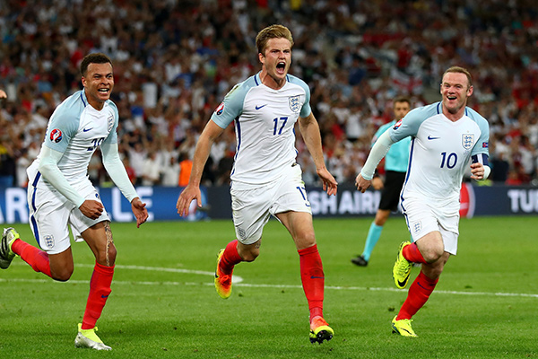 Eric Dier (C) of England celebrates scoring his team's first goal with his team mates Dele Alli (L) and Wayne Rooney (R) during the UEFA EURO 2016 Group B match between England and Russia at Stade Velodrome on June 11, 2016 in Marseille, France. (Photo by Lars Baron/Getty Images)
