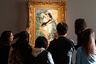 visitors to the Christie's auction to inspect the painting of Edouard Manet