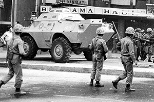 Soldiers disperse demontrators in Ankara streets 300 meters from the parliament few days defore a acoup in this Sept. 1980 photo. The army took over the country to quell leftist-rightist street battles that were killing about a dozen people a day.