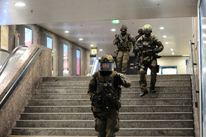 Policemen walking down stairs and securing the area in the underground station Karlsplatz (Stachus) after a shootout in Munich, Germany, 22 July 2016. After a shootout in the Olympia shopping centre in Munich, injuries and possible deaths were reported by the police. The situation is still unclear. PHOTO: ANDREAS GEBERT/dpa