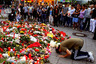 A man prays beside flowers laid in front of the Olympia shopping mall, where yesterday's shooting rampage started, in Munich, Germany July 23, 2016. REUTERS/Arnd Wiegmann     TPX IMAGES OF THE DAY      - RTSJCX2