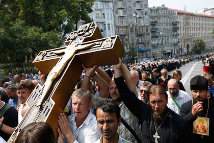 Orthodox believers and clergymen participate in a procession in downtown Kiev, Ukraine, Wednesday, July 27, 2016, in observance of the holiday marking the adoption of Christianity by what is now Russia and Ukraine in the 10th century. They are to commemorate the day at the hillside monument in central Kiev to Saint Volodymyr, the prince who enacted the adoption of Christianity. (AP Photo/Sergei Chuzavkov)