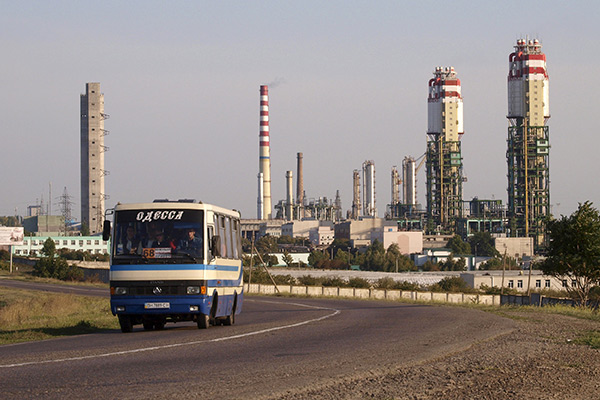 A bus drives along a road, with Odessa Portside Plant (OPP) seen in the background, in the Black Sea port city of Odessa, in this September 29, 2009 file photo.