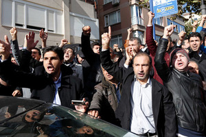 Supporters of Gulen movement shout slogans during a protest outside the Kanalturk and Bugun TV building in Istanbul, Turkey, October 28, 2015. Turkish police on Wednesday stormed the offices of an opposition media company, days before an election, in a crackdown on companies linked to a U.S.-based cleric and foe of President Tayyip Erdogan, live footage showed. Brawls broke out and police sprayed water cannon to disperse dozens of people in front of the offices of Kanalturk and Bugun TV in Istanbul, a live broadcast on Bugun's website showed. The media groups are owned by Koza Ipek Holding, which has links to Islamic preacher Fethullah Gulen. REUTERS/Murad Sezer - RTX1TLEF