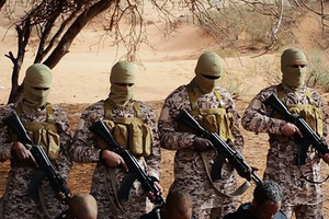 "An image grab taken on April 19, 2015 from a video reportedly released by the Islamic State (IS) group through Al-Furqan Media, one of the Jihadist platforms used by the militant organisation on the web, purportedly shows men described as Ethiopian Christians captured in Libya kneeling on the ground in front of masked militants before their execution in a desert area at an undisclosed location in Libya. The video released online purportedly shows the executions of 30 Ethiopian Christians captured in Libya, with the footage showing one group of about 12 men being beheaded by militants on a beach and another group of at least 16 being shot in the head in a desert area. AFP PHOTO / HO / AL-FURQAN MEDIA == RESTRICTED TO EDITORIAL USE - MANDATORY CREDIT ""AFP PHOTO / HO / AL-FURQAN MEDIA "" - NO MARKETING NO"
