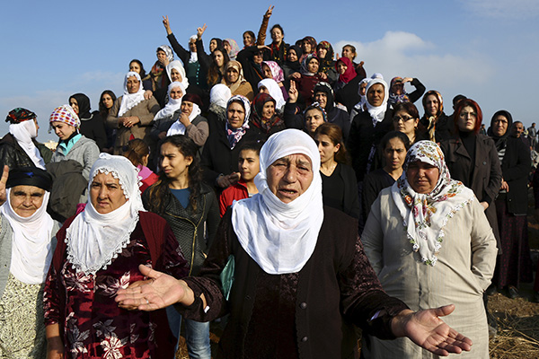 Women react during the funeral of Diyarbakir Bar Association President Tahir Elci in the Kurdish-dominated southeastern city of Diyarbakir, Turkey, November 29, 2015. Thousands gathered for the funeral of Elci, a Kurdish lawyer and human rights activist gunned down on Saturday in a southern eastern city at the centre of months of violence.