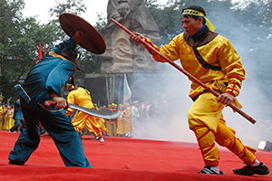 Actors re-enact a battle between Vietnamese (yellow) and Chinese soldiers (blue) during the 224th Dong Da Festival in Hanoi