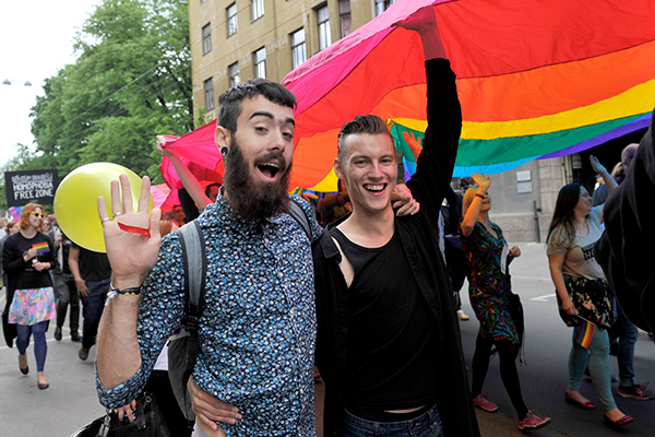 Participants in a gay pride parade carrying a huge rainbow flag, march in Riga, Latvia, Saturday, June 20, 2015. Up to 5,000 people have participated in a high-profile gay pride event in the capital of Latvia, a former Soviet country. (AP Photo/Oksana Dzadan)