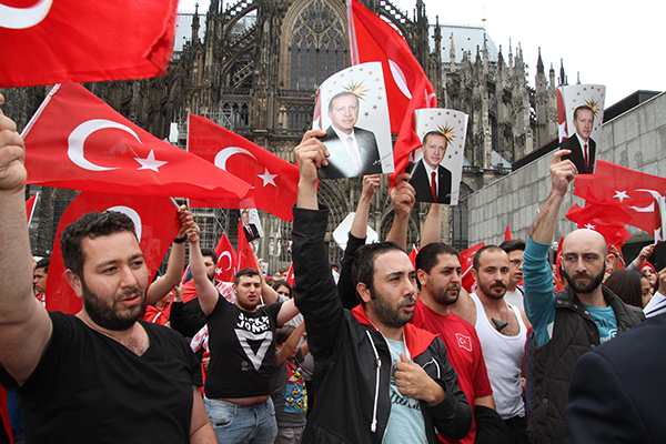 People gather in front of Cologne Cathedral to protest the attempted military coup in Turkey, on July 16, 2016 in Cologne, Germany. (Photo by Mesut Zeyrek/Anadolu Agency/Getty Images)