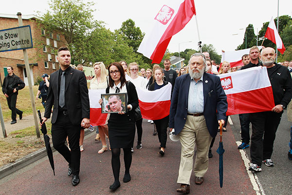 Members of the Polish and local community join a silent march in Harlow, Essex, Britain, 03 September 2016, to pay tribute to Polish national Arkadiusz Jozwik (seen on picture in foreground) who was murdered outside a takeaway shop in Harlow on 27 August 2016.