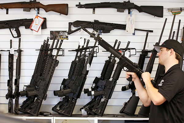 "Salesman Ryan Martinez clears the chamber of an AR-15 at the ""Ready Gunner"" gun store In Provo, Utah, U.S. in Provo, Utah, U.S., June 21, 2016. REUTERS/George Frey"