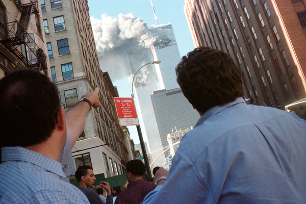 FILE PHOTO - Pedestrians react to the World Trade Center collapse September 11, 2001.