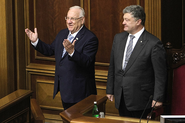 September 27, 2016 - Kiev, Ukraine - President of Israel Reuven Rivlin (L) and Ukrainian President Petro Poroshenko (R) attend a parliamentary hearings on ''The 75th anniversary of the Babyn Yar tragedy: History Lessons and Modernity'' at Ukrainian Parliament Verkhovna Rada, September 27, 2016.President of Israel Reuven Rivlin visits Ukraine for the first state visit