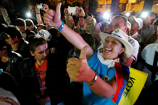 "Supporters of ""No"" vote celebrate after the nation voted ""No"" in a referendum on a peace deal between the government and Revolutionary Armed Forces of Colombia (FARC) rebels, in Bogota, Colombia, October 2, 2016"
