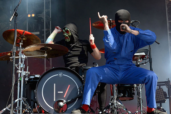 HOUSTON, TEXAS - APRIL 02:  Musicians Josh Dun (L) and Tyler Joseph of Twenty One Pilots perform on stage during the Coke Zero Music Mix at the NCAA March Madness Music Festival Day 2 at  Discovery Green on April 2, 2016 in Houston, Texas.