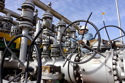 A worker checks the valves at Al-Sheiba oil refinery in the southern Iraq city of Basra