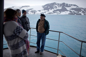 In this Jan. 27, 2015 photo, tourists stand on The Aquiles, a Chilean Navy icebreaker, near Bahia Almirantazgo, Livingston Island, South Shetland Island archipelago, Antarctica. Although many tourists are nature-loving retirees who mostly stay aboard cruise ships, conservationists worry about potentially devastating environmental damage from boat pollution and from the more adventurous visitors who hike or cross-country ski around sensitive sites. (AP Photo/Natacha Pisarenko)